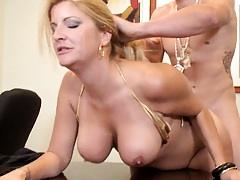 Big tits boss gets fucked on her own desk