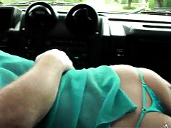 Milf reaches around and starts to suck the drivers cock