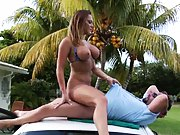 Sexy busty milf rides cock on roof of a car