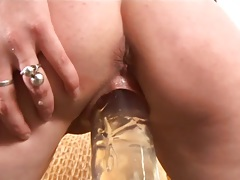 Riding her dildo with ass spreading close up