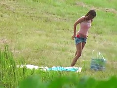 Spying on a hot teen tanning outdoors