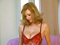 Natural big tits Vanessa B taking off her lingerie top and spreading legs
