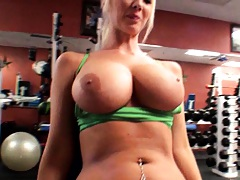 Two busty babes alone at the gym having a work out