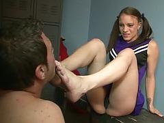 Cheerleader teen Kirra Lynne gets her feet licked while wearing uniform in locker room